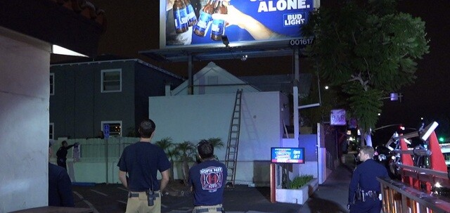 Man holds San Diego Police at bay from top of billboard