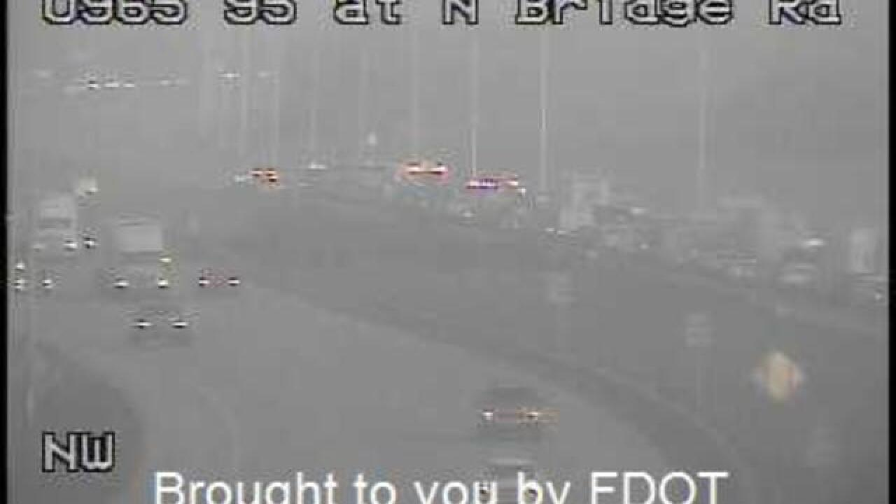 FHP trooper hit by car while working crash on I-95 in Martin County