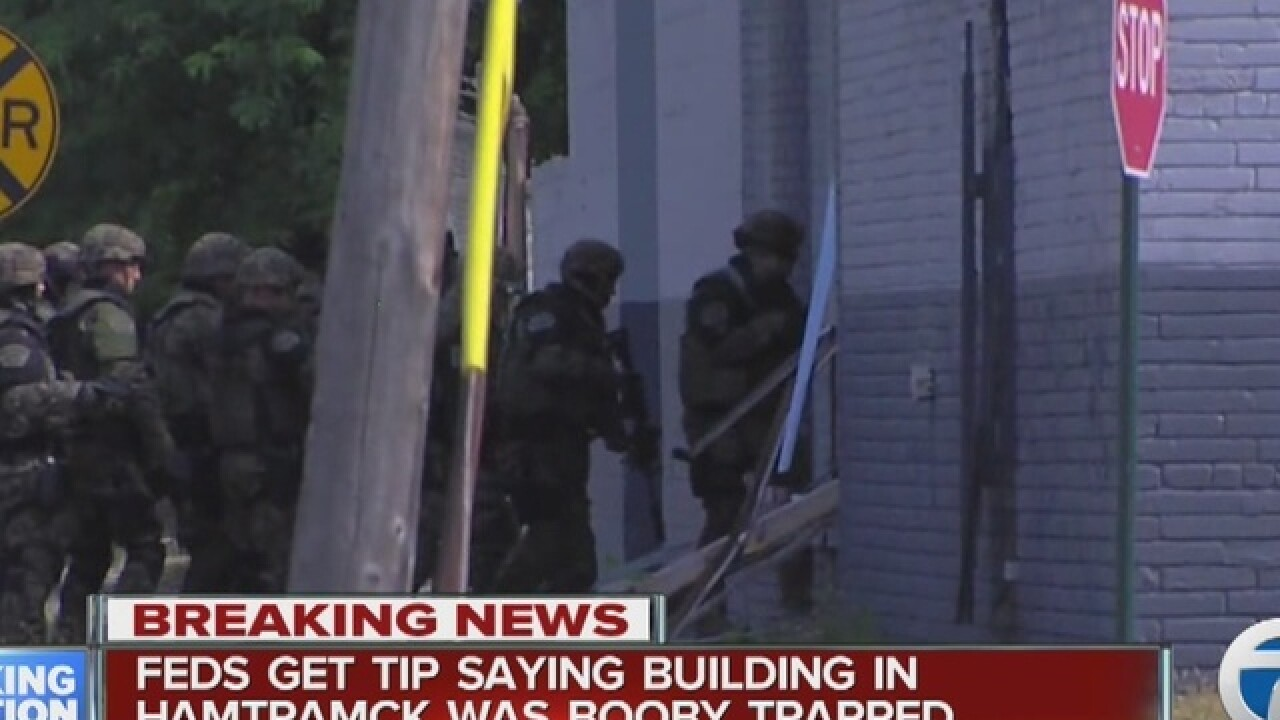 Police, bomb squad searching Detroit building
