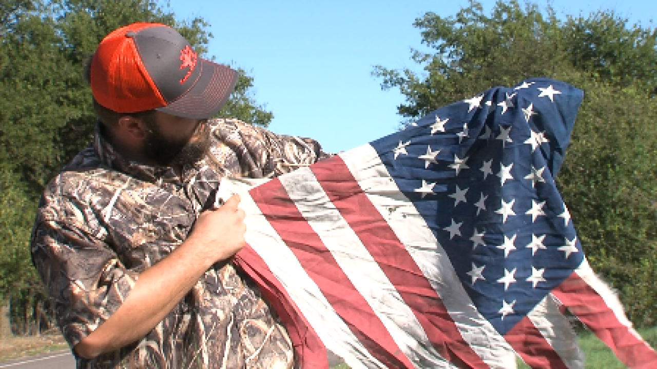Disabled Army veteran rescues flag being run over by cars
