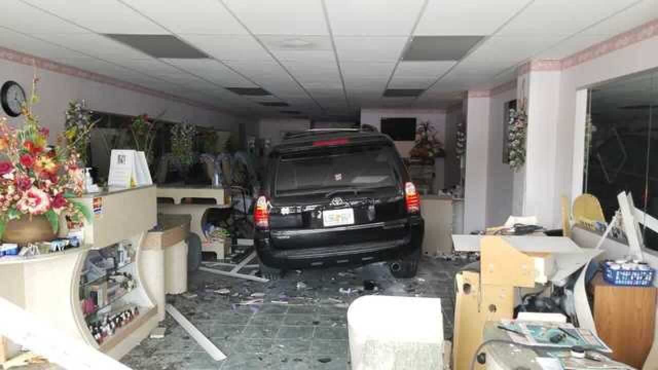 One person injured when SUV drives into business