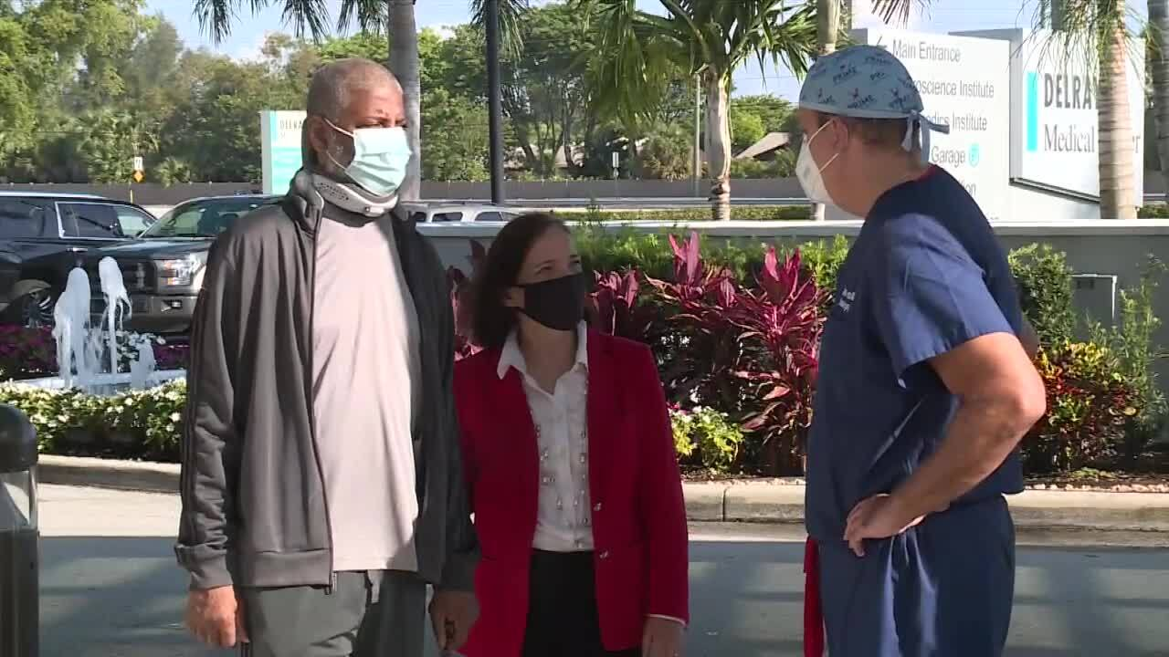 Dr. Joseph Ricotta meets with patients Frederica and Lamar Davis at Delray Medical Center