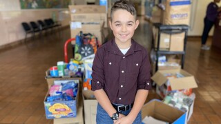 Mason Dorsett in front of donated supplies