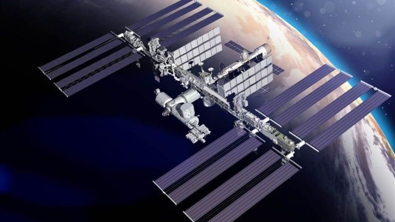 ISS over Earth background
