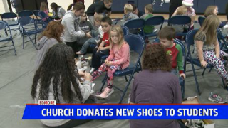 Church gives new shoes to Montabella students