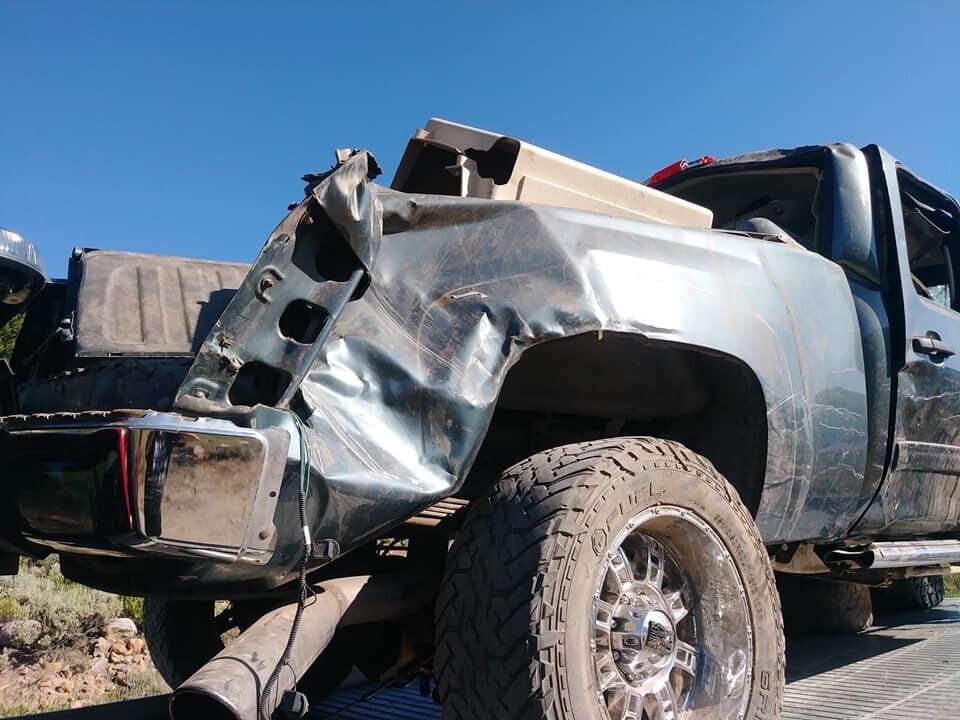 Photos: 2 dead, 5 taken to hospital after truck rolls down embankment in WeberCounty