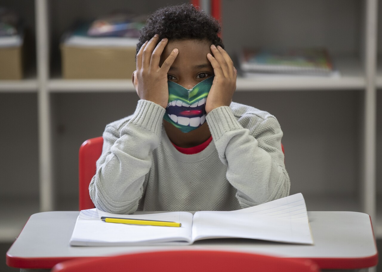 A student wears a mask on the first day back to in-person classes amid the COVID-19 pandemic at the Raul Antonio Fragoso public school in Sao Paulo, Brazil, Monday, Feb. 8, 2021.