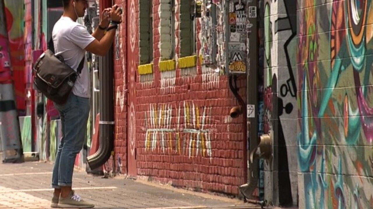 Businesses see boost by hiring artists to paint murals on their buildings