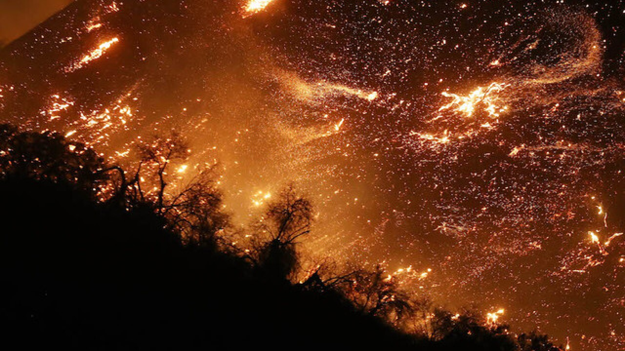 California fires: 'Firefighters taking a beating' as Santa Ana winds stoke blazes