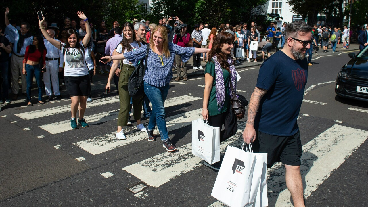 Abbey Road endures more traffic mayhem as Beatles fans mark last album's 50th anniversary