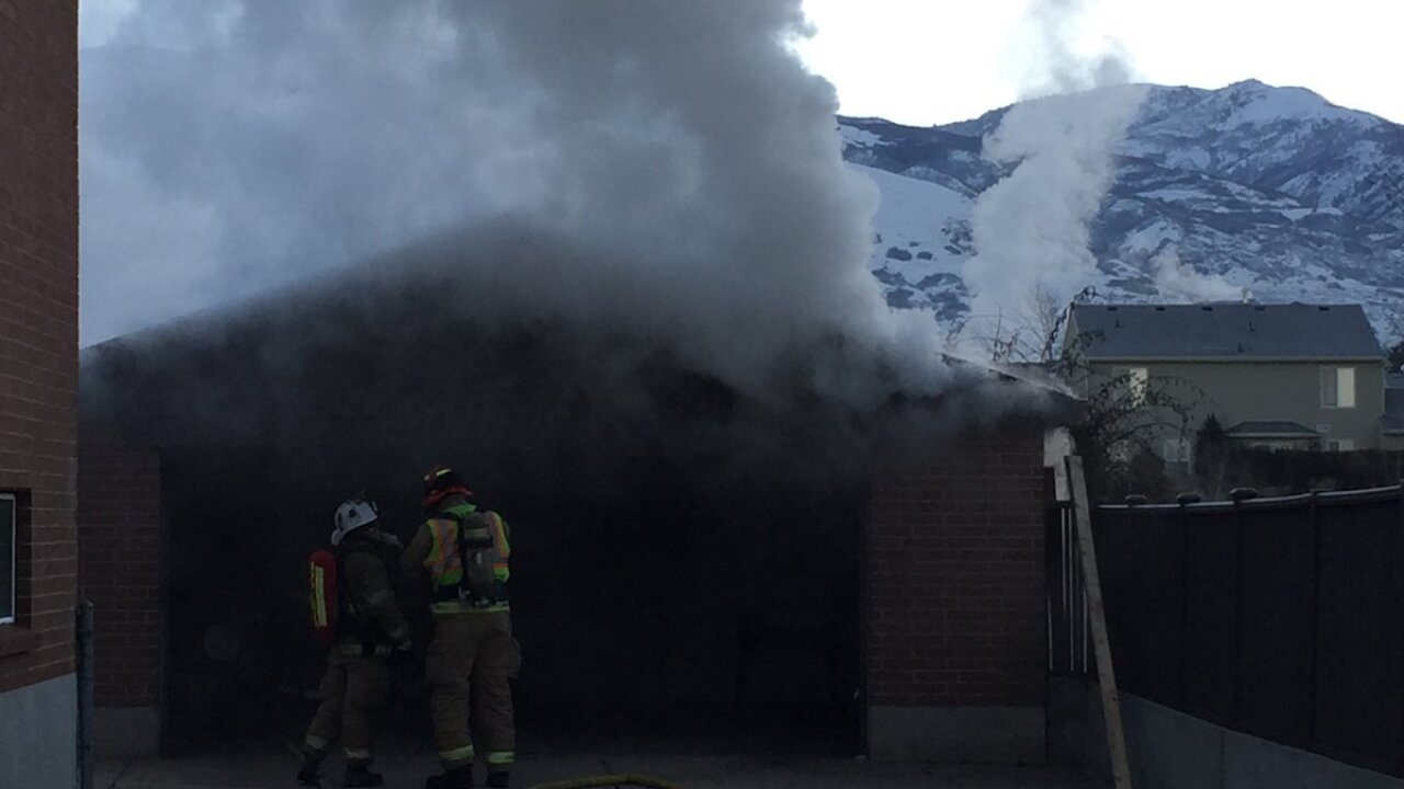 Firefighters battle garage fire in West Bountiful