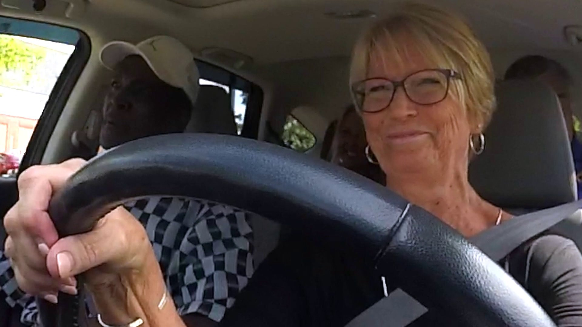 Photos: Tracy Sears surprises 3-time cancer survivor who volunteers to drive cancer patients to appointments