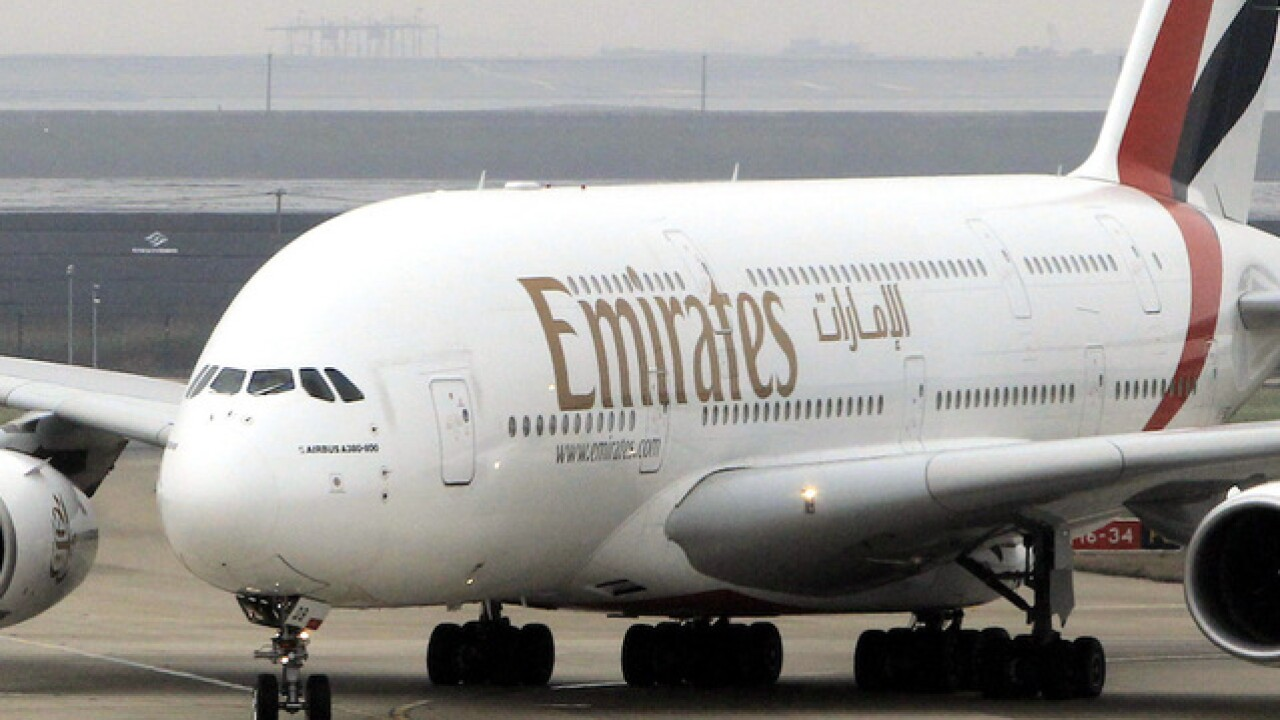 Emirates airline officials say 10 passengers fell ill on flight that landed at JFK