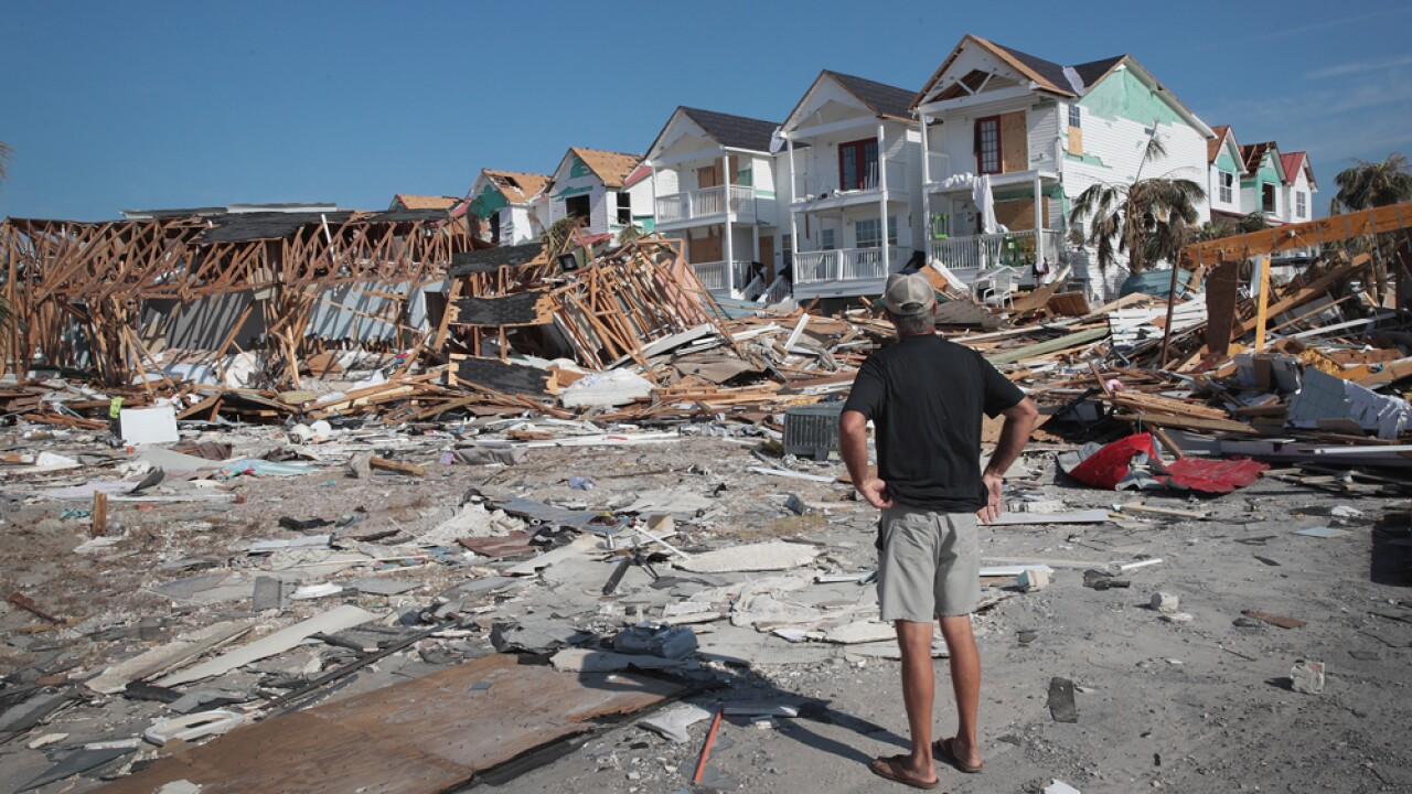 James Whiddon looks over damage caused by Hurricane Michael on October 19, 2018 in Mexico Beach, Florida. Hurricane Michael slammed into the Florida Panhandle on October 10, as a category 4 storm causing massive damage and claiming over 30 lives.