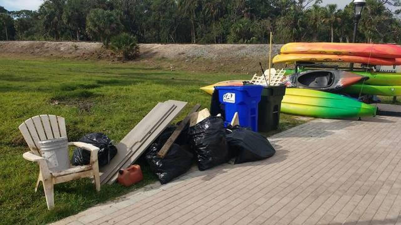 Volunteers help clear hurricane debris in river