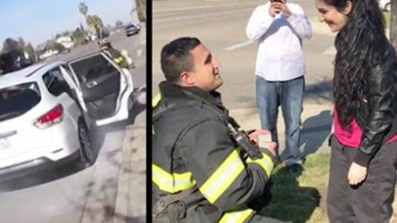 Firefighter proposal stuns woman
