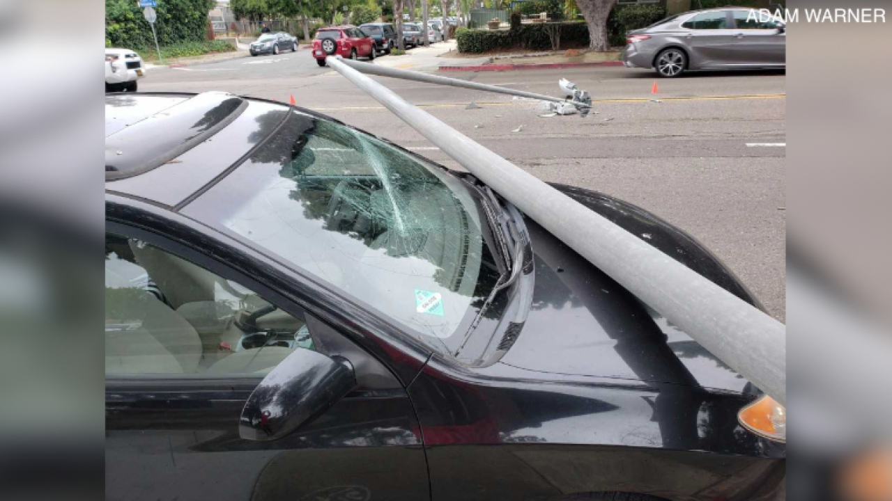 Light pole crashes on top of car in Pacific Beach