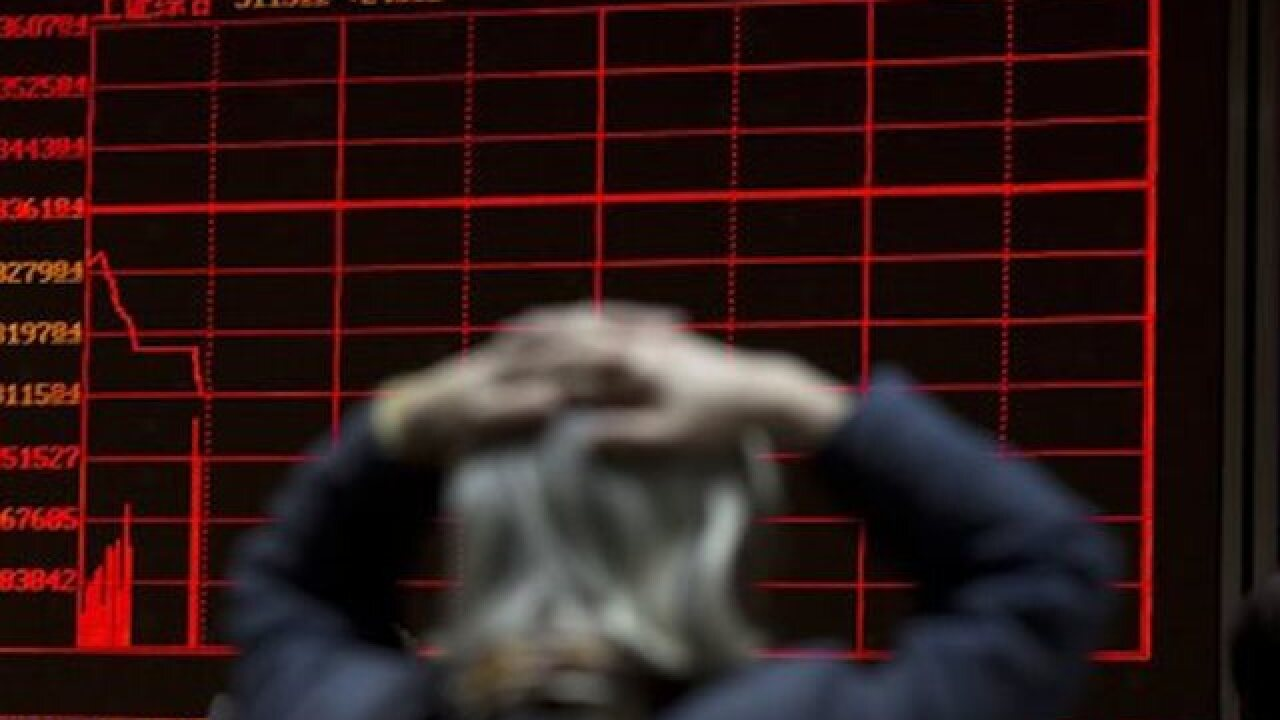 World stocks slide as China trading halted