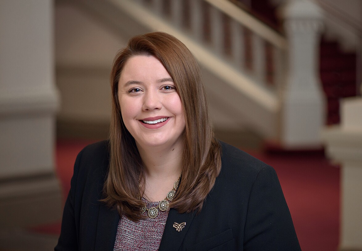 Samantha Molony is applied research director for the Women's Fund of the Greater Cincinnati Foundation. She has long, brown hair and is wearing a printed blouse and dark jacket in this photo.