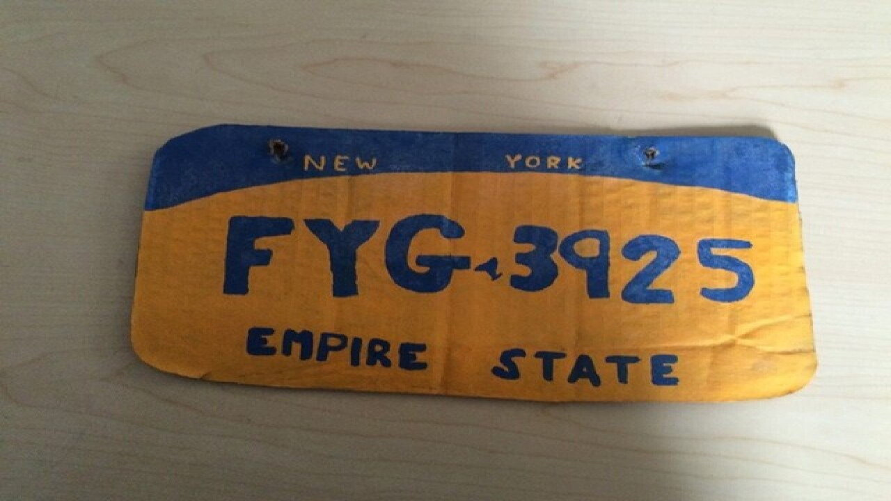 Woman accused of crafting her own license plate