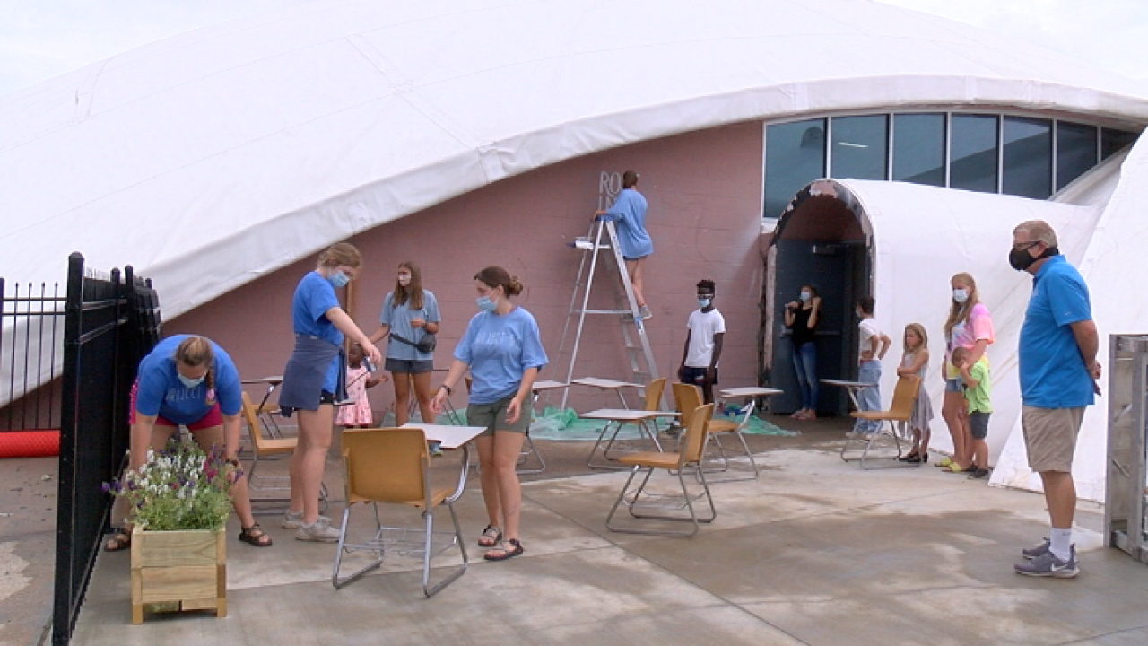 Project 61 volunteers work on 61 different service project for children in the community