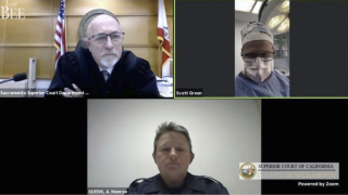 Dr. Scott Green appears in court video call while performing surgery