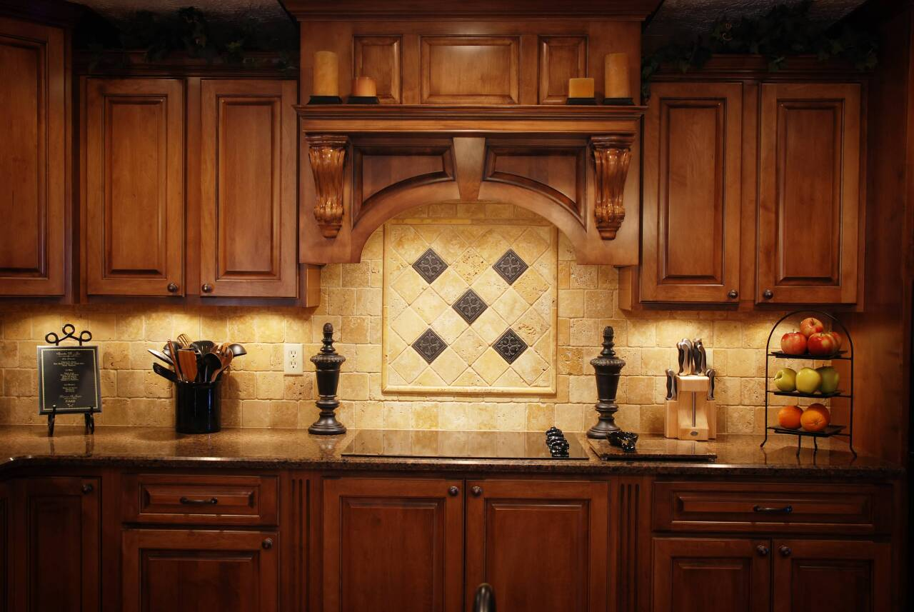 A newly refinished set of kitchen cabinets decorated for the fall season.