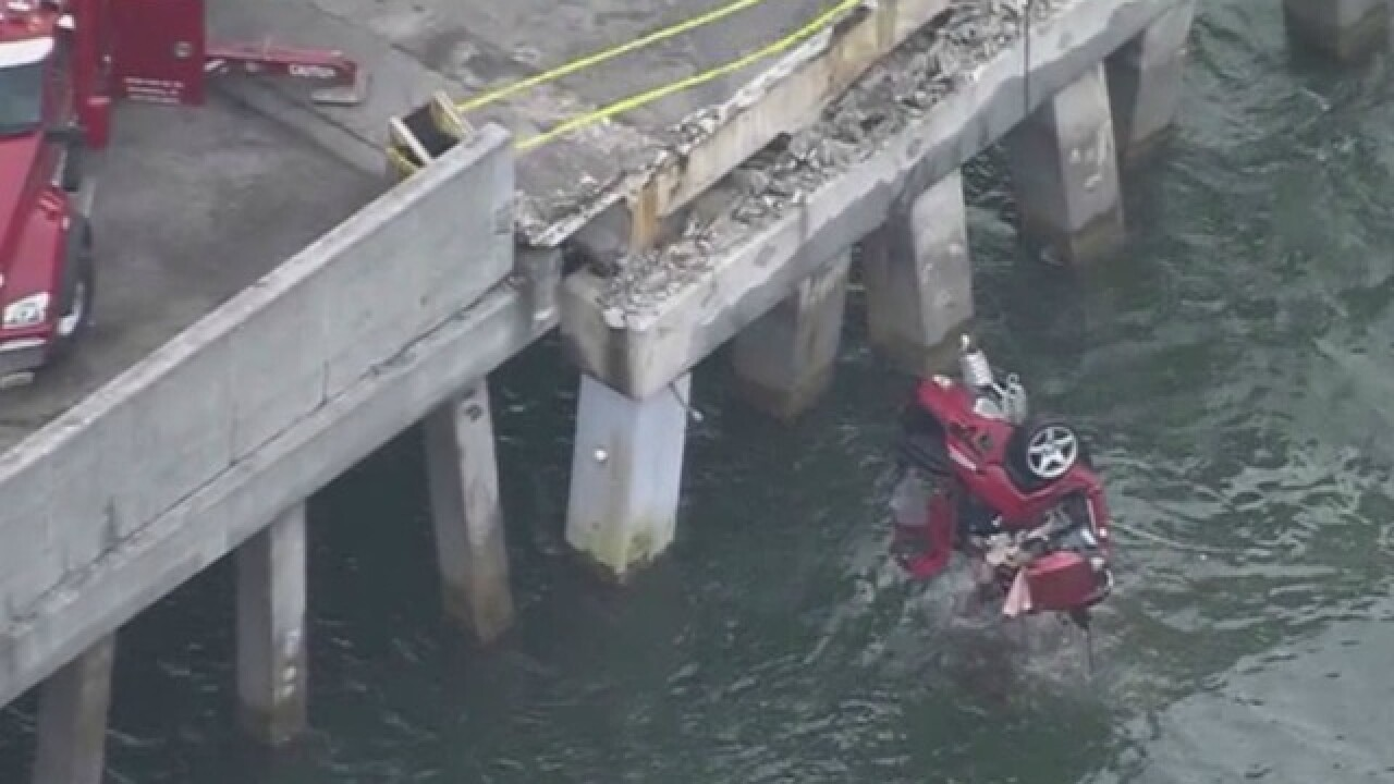 Vehicle drives off fishing pier south of Skyway