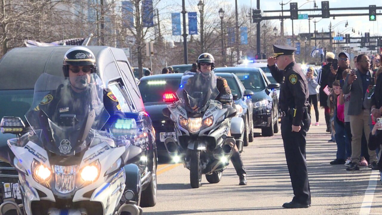 Processional honors slain Newport News officer: 'She's our sister'