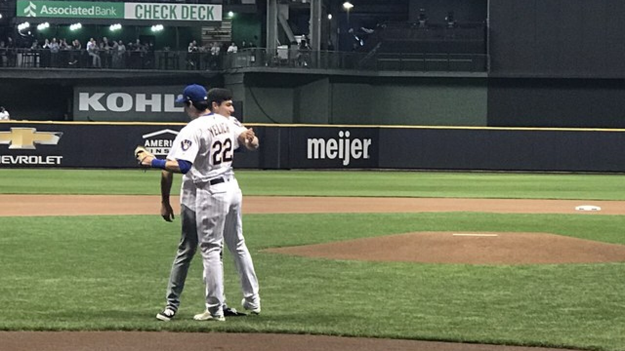Yelich's brother throws out first pitch as excitement builds around Brewers