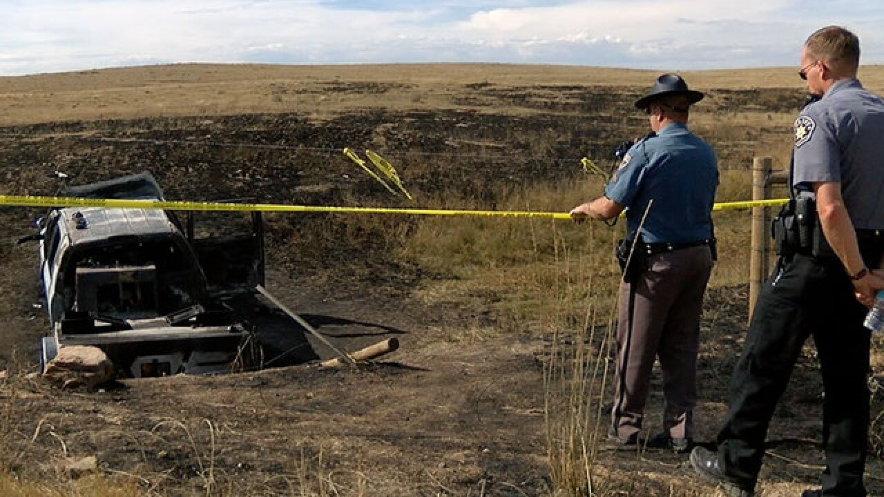 2 arrested after bodies found in burned truck