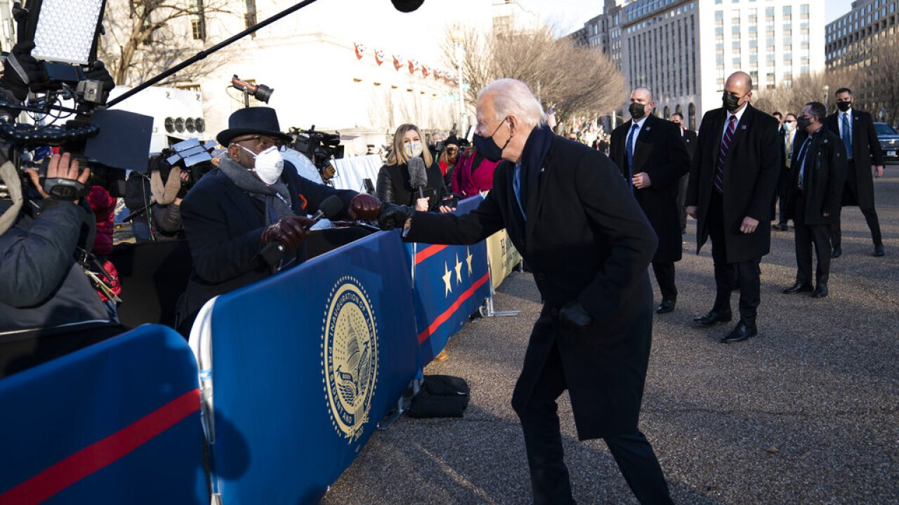 Al Roker, Joe Biden exchange fist bumps along inauguration parade route.