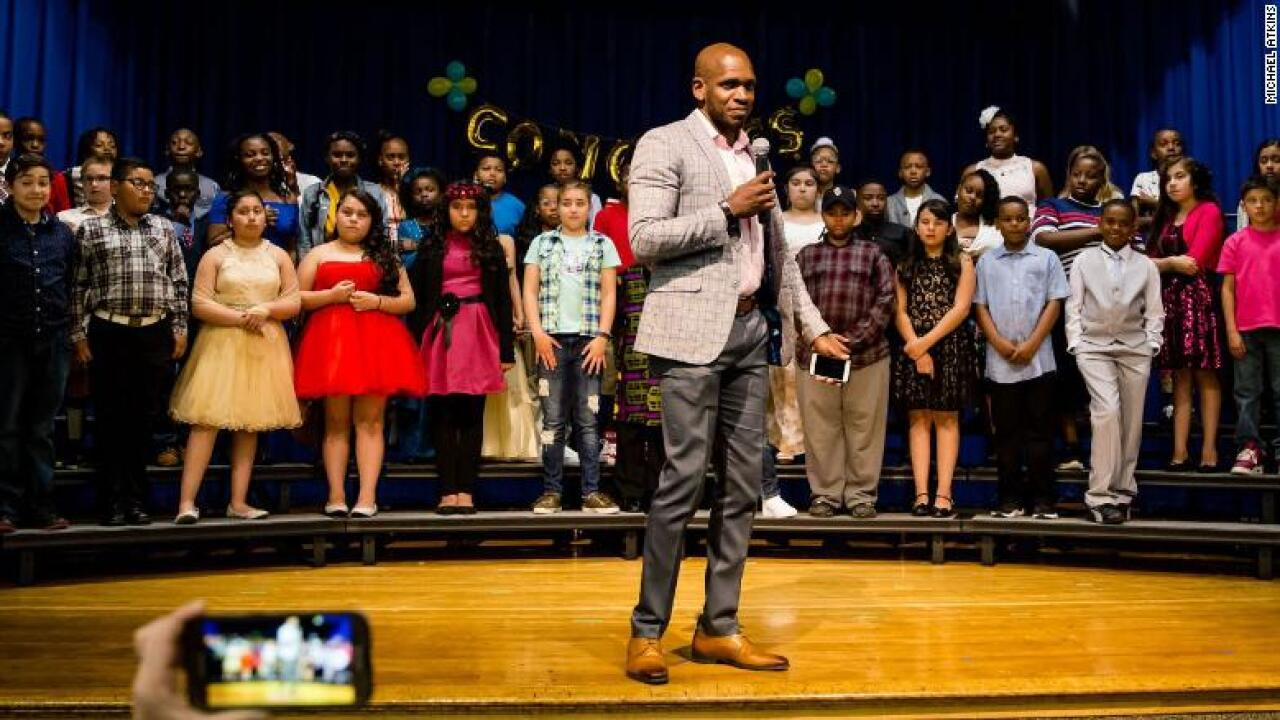 He started as a custodian. Now he's a principal in the same school district.