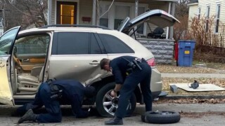 grpd officers change flat tire.jpg