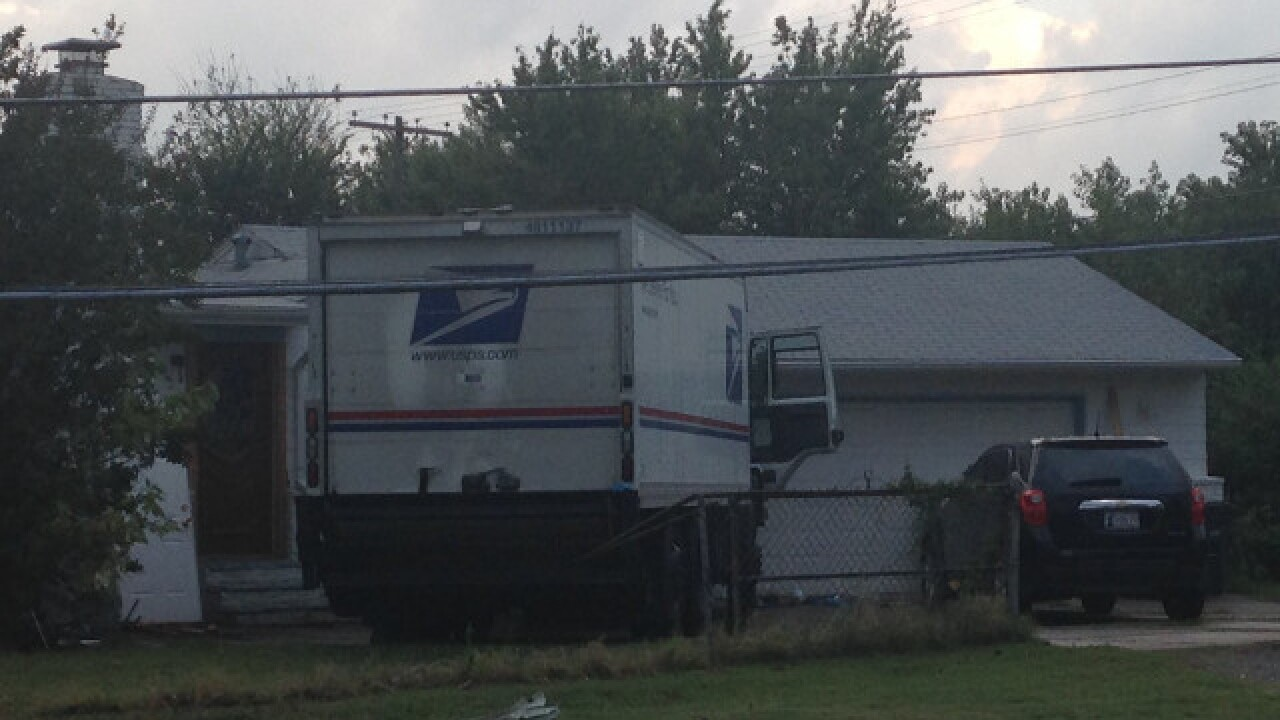 USPS mail truck crashes into electrical pole, comes to rest in yard