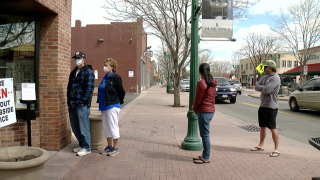 A line forms outside of Rhineland Bakery in Arvada