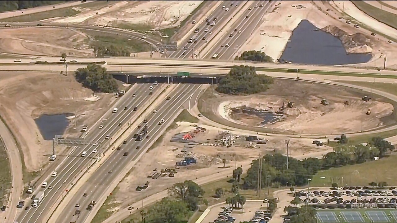 Bird's eye view of construction to Glades Road interchange at I-95
