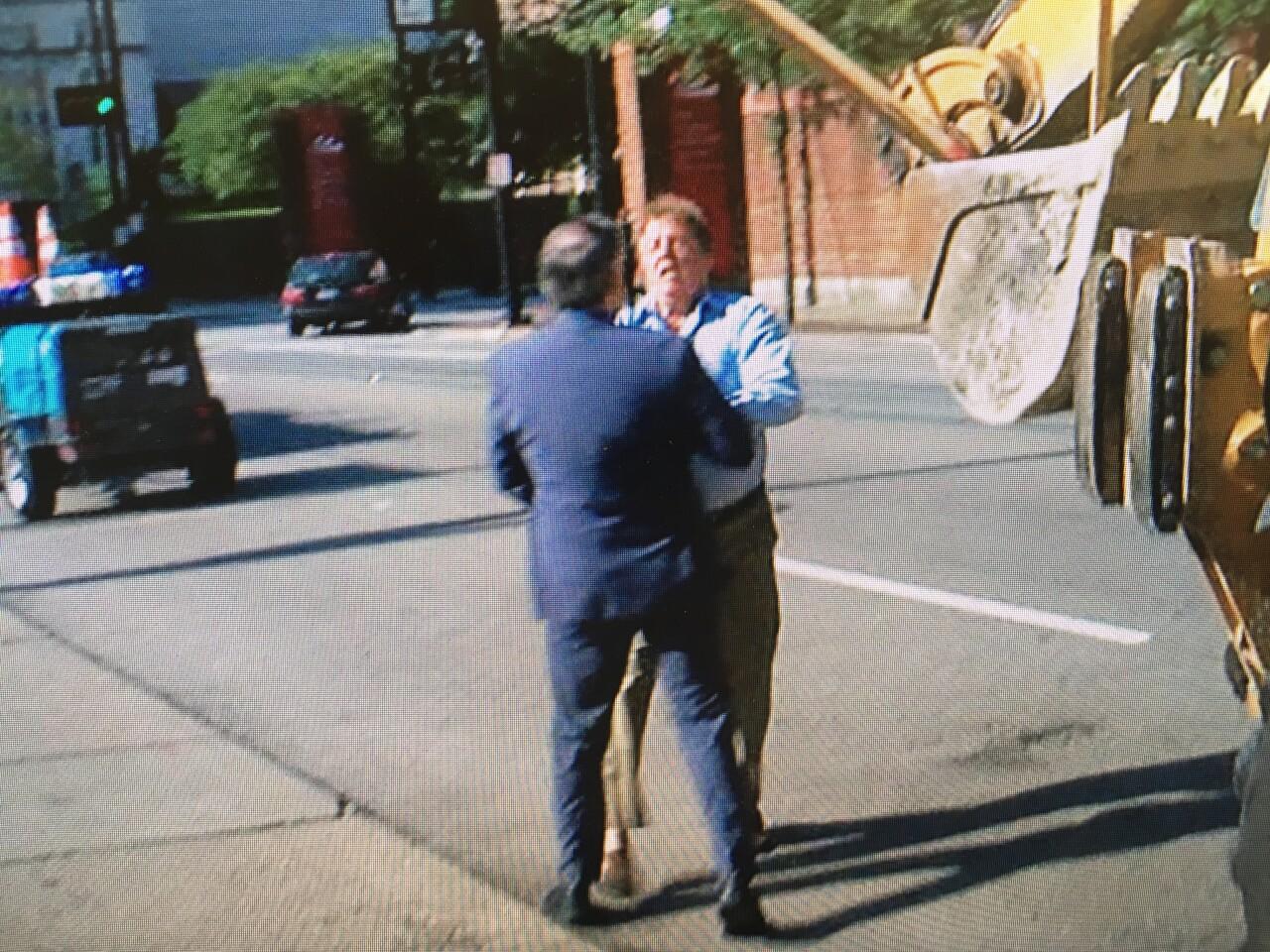 John Klosterman pushes WCPO reporter Craig Cheatham