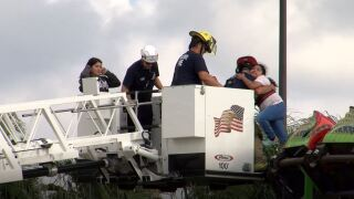 Firefighters rescue girls from stuck roller coaster