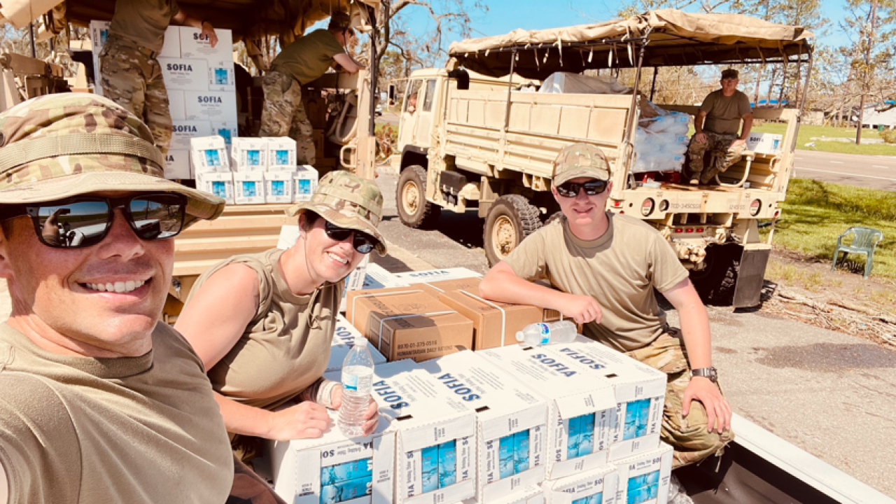 Oklahoma Air National Guard Staff Sgt. Macey Winegarner (center) helps distribute water to residents affected by Hurricane Ida in Louisiana, Sept. 09, 2021. (Photo Courtesy Staff Sgt. of Macey Winegarner)