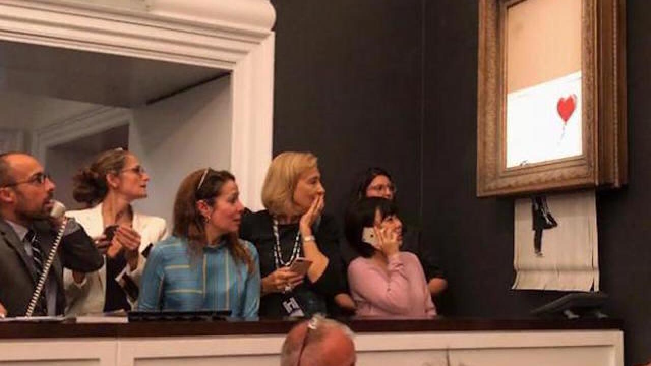 Who was in on Banksy's 'self-destruct' painting?