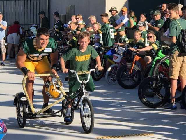 cbf0a87a Kids Bike Ride Kicks Off Green Bay Packers Training Camp