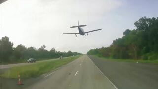 plane landing on highway.JPG