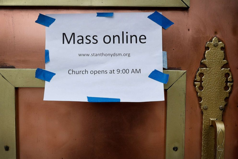 A sign on the front door of the St. Anthony's Catholic Church directs parishioners to the availability of online mass, Friday, March 27, 2020, in Des Moines, Iowa. Daily masses continue to be available... moreA sign on the front door of the St. Anthony's Catholic Church directs parishioners to the availability of online mass, Friday, March 27, 2020, in Des Moines, Iowa. Daily masses continue to be available online in response to the new coronavirus outbreak but the church is open daily for private prayers. (AP Photo/Charlie Neibergall) Charlie Neibergall/AP