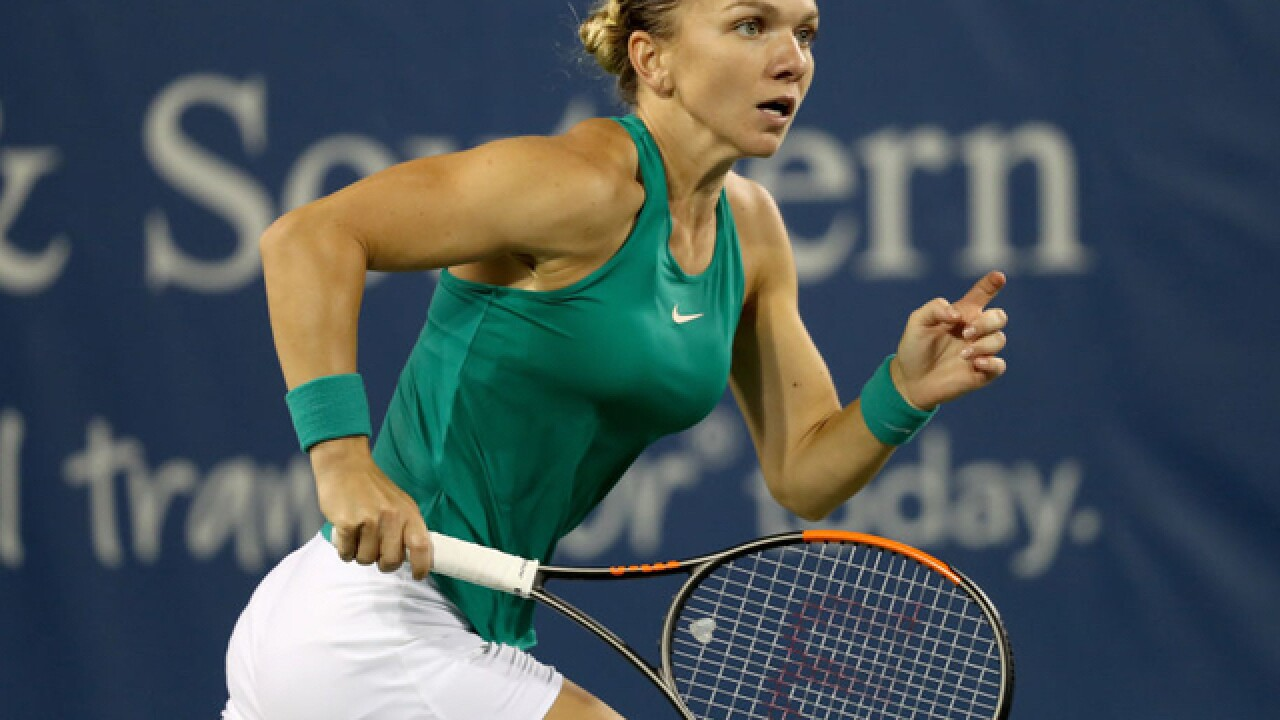 No. 1 Halep wins suspended match, advances at Cincinnati