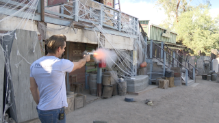 Pistoleros Wild West Show owner and actor Jerry Woods fires a blank round on the show's set at Trail Dust Town in Tucson.