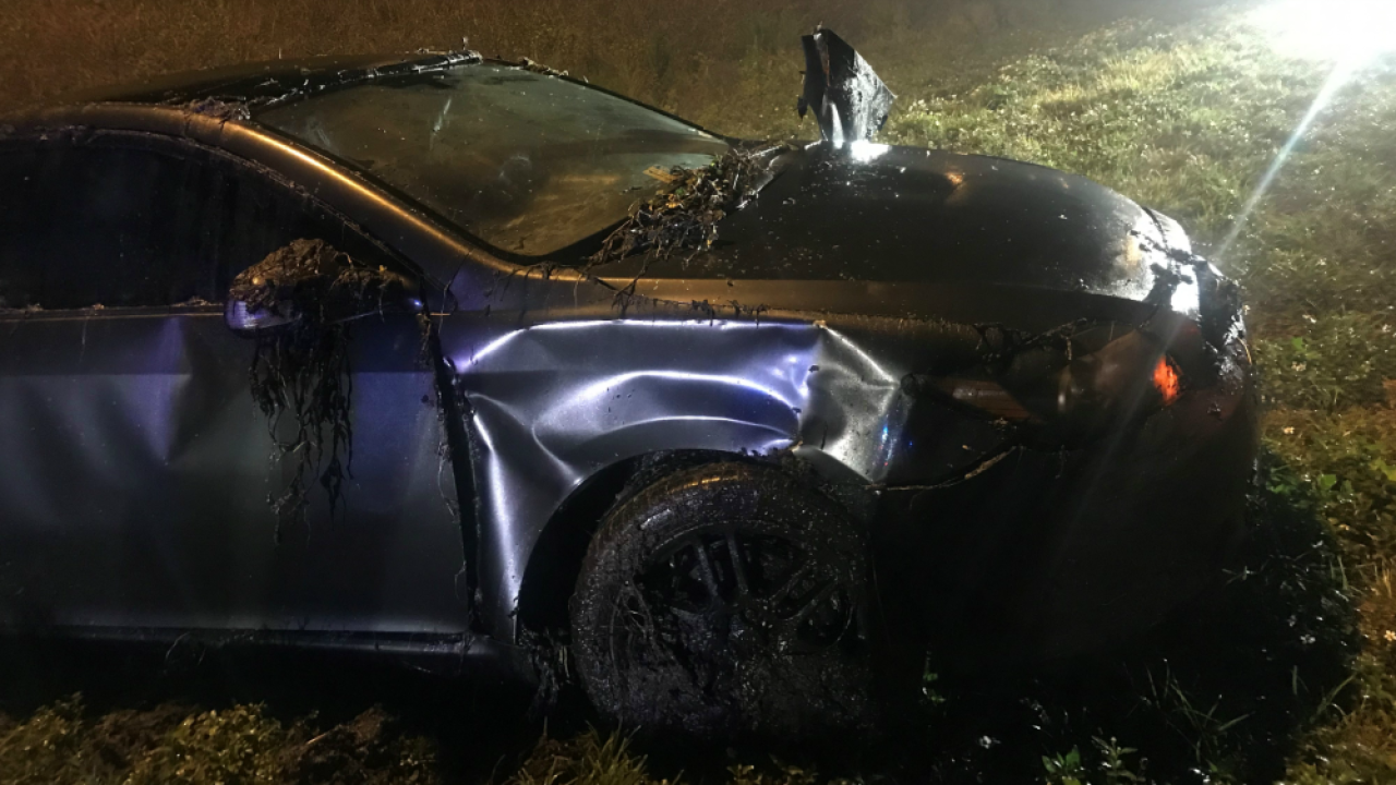 woman trapped in sinking Toyota Scion