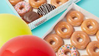 Buy a dozen Krispy Kreme donuts and get another dozen for $1