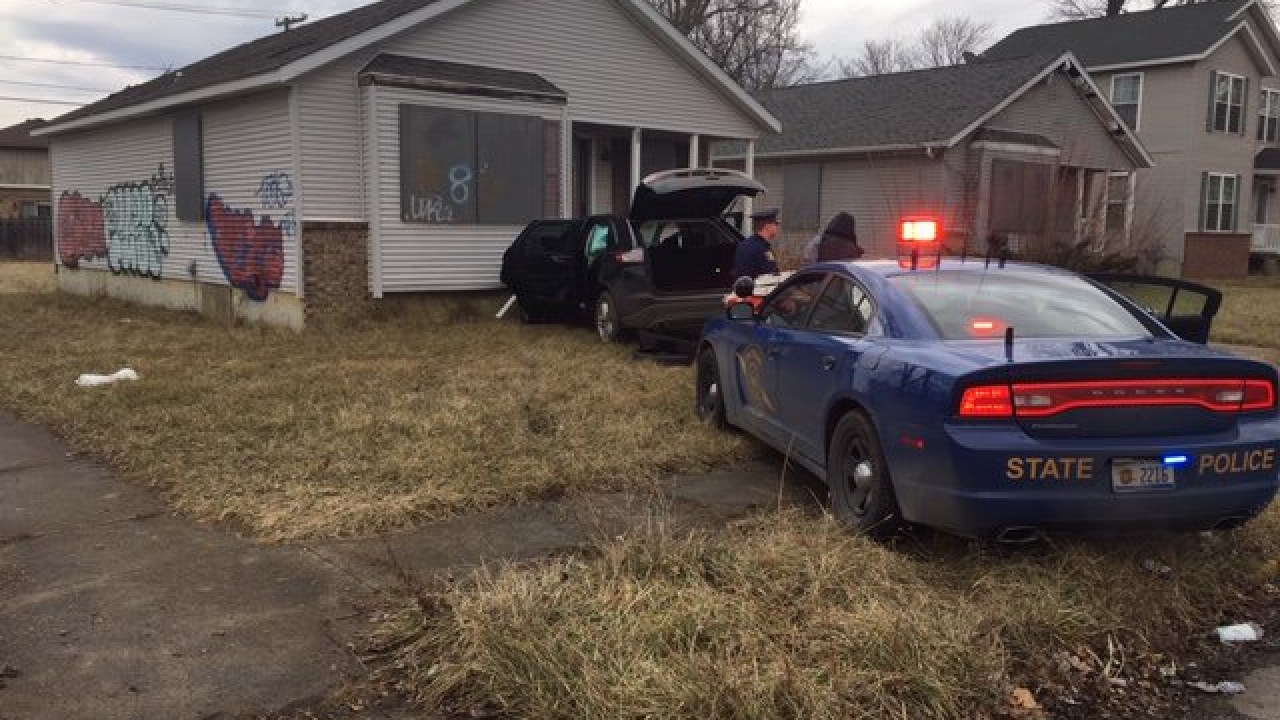 Suspect Evading Police Crashes Into Abandoned Home In