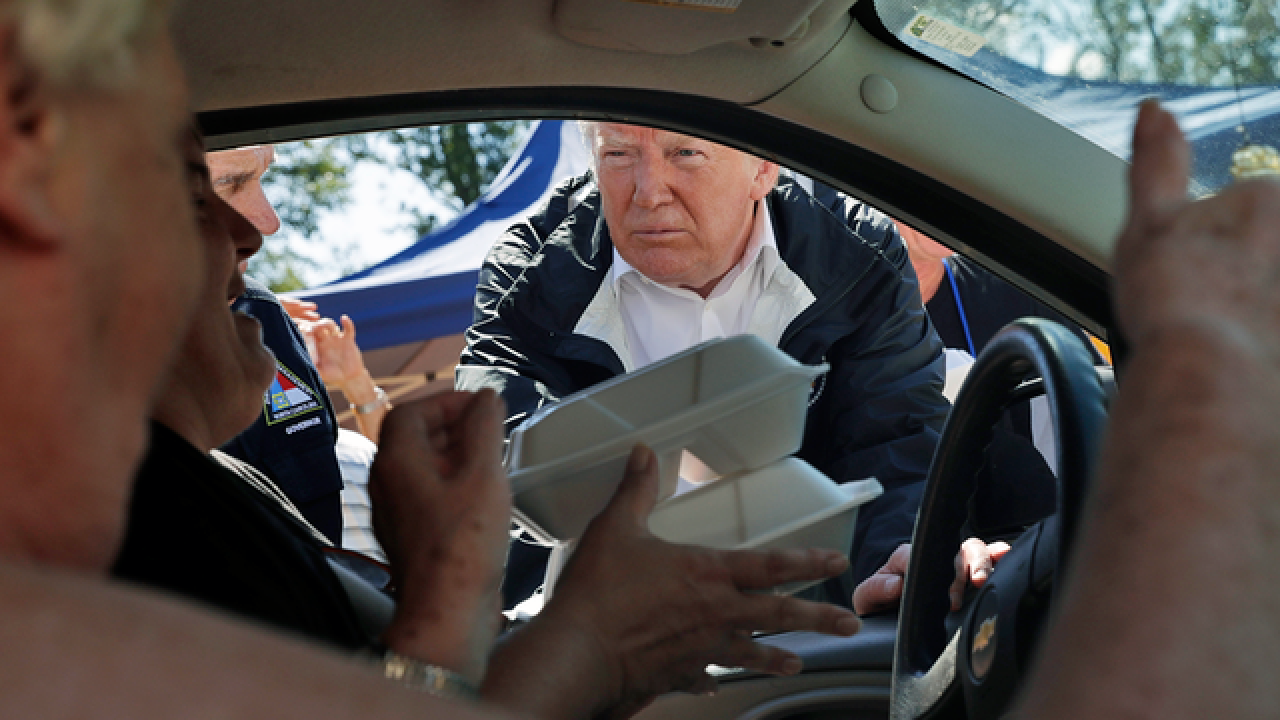 President Trump hands out warm meals to Florence victims
